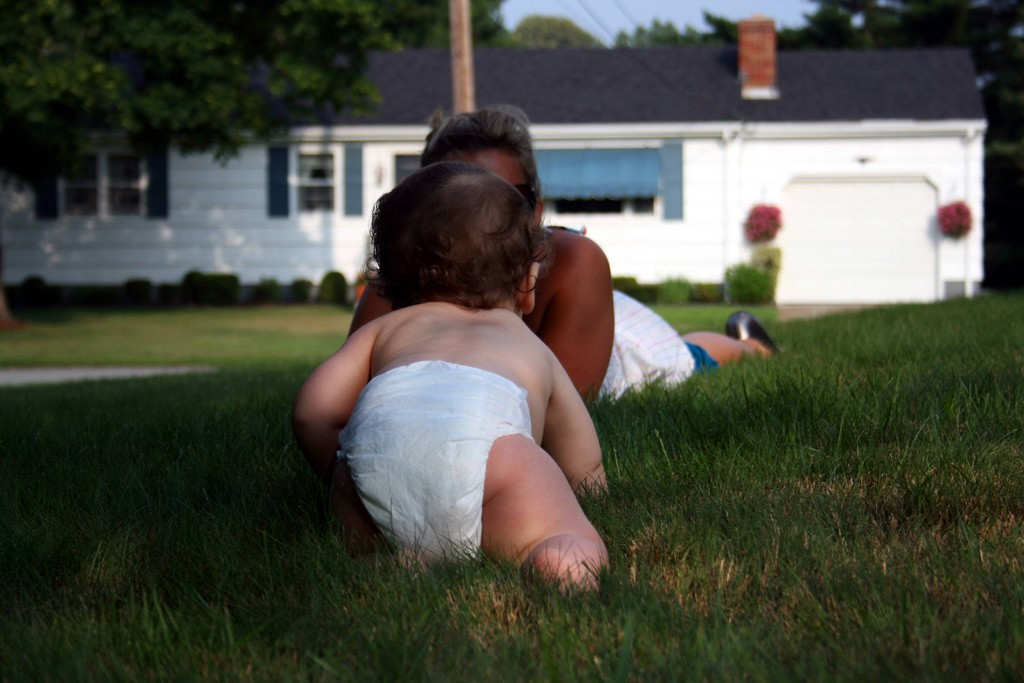 baby crawling on lawn