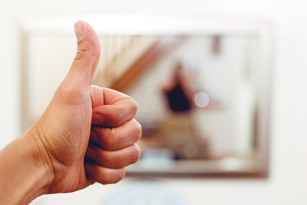 A thumbs up or other hand signal can help you turn away from harsh self-criticism