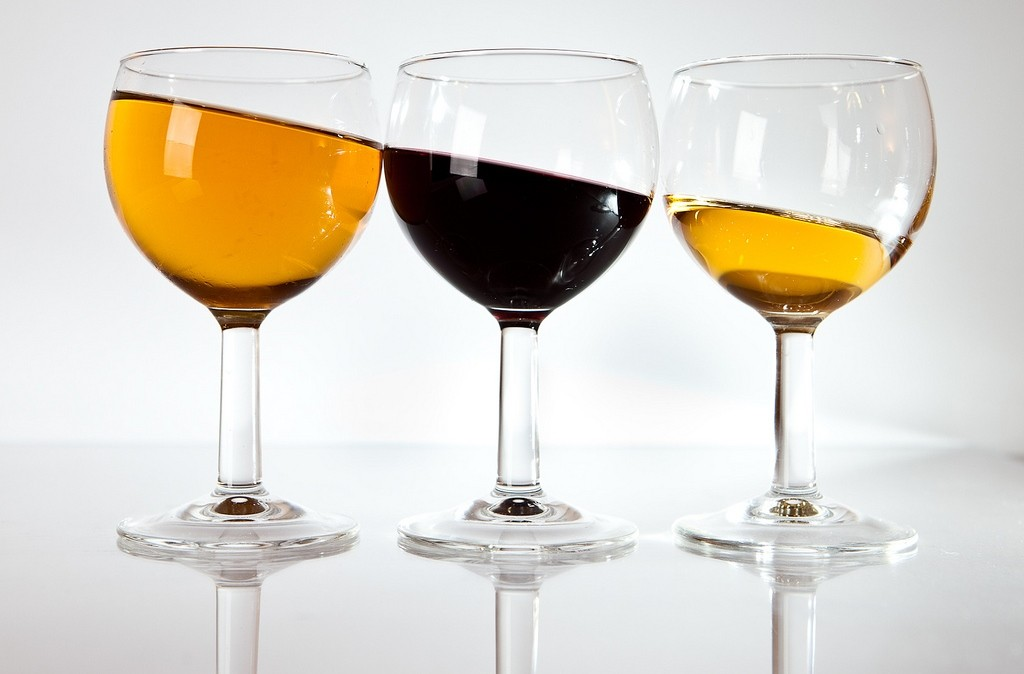 Picture of tilted fluid levels in 3 glasses. Harsh self-criticism punishes you for human imperfection.